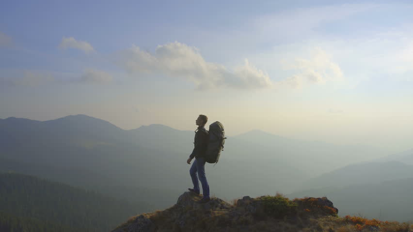 3 in 1 video! The hiker stand on the top of the mountain. Real time capture. Wide angle | Shutterstock HD Video #20550520