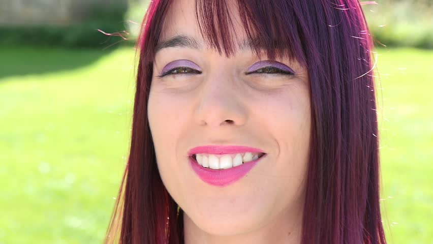 Portrait of a pretty young woman with red hair, outdoor, slow motion | Shutterstock HD Video #20561707