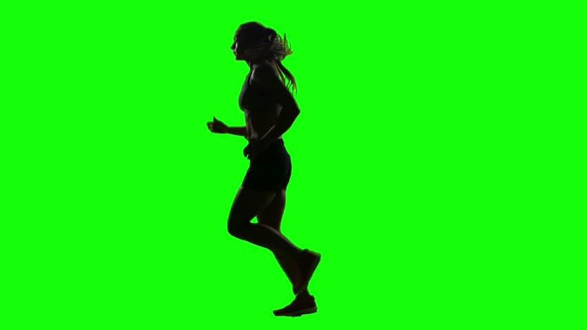 Running sport girl. Side view. Green screen. Silhouette