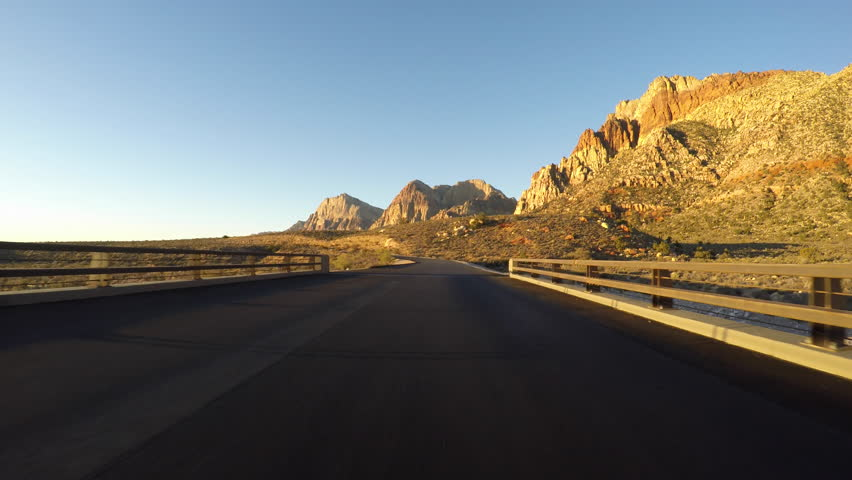 Sunrise driving at Red Rock Canyon National Conservation Area. A popular natural destination 20 miles from the Las Vegas strip. | Shutterstock HD Video #20577703