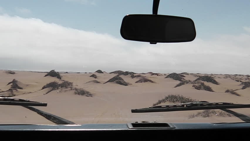 First person view on dunes of Sandwich Harbour, Walvis Bay, It's a part of the Namib Naukluft Park Namibia. Wild and remote area accessible only by off-road cars. | Shutterstock HD Video #20590207