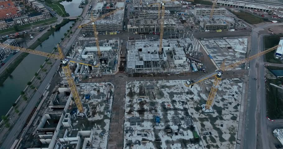 Drone footage of construction sight with cranes | Shutterstock HD Video #20593195