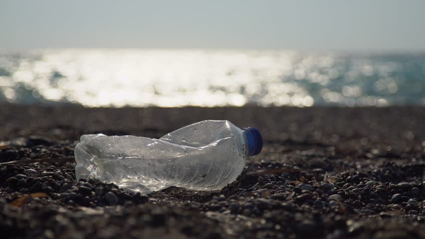 Environmental pollution:Plastic bottles at a coast. Video footage clip in UHD, 4K. | Shutterstock HD Video #20604784