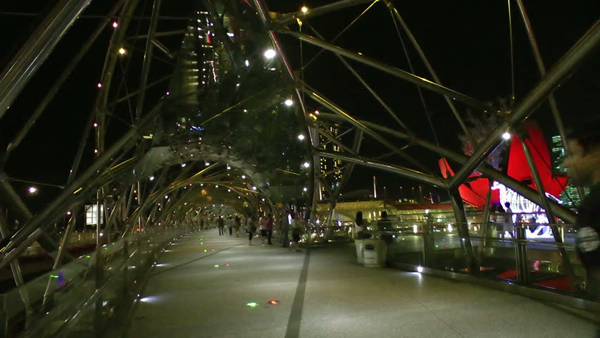 SINGAPORE - CIRCA DECEMBER 2011: Tourists walking along Helix bridge decorated for Christmas, circa December 2011