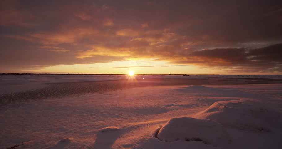 Time lapse - clouds rushing over tundra at sunset with snow | Shutterstock HD Video #20650885