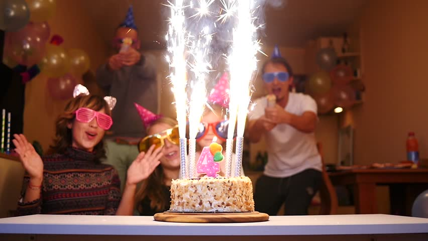 Cheering people birthday party - firework candles cake, colorful streamers confetti fly | Shutterstock HD Video #20665777