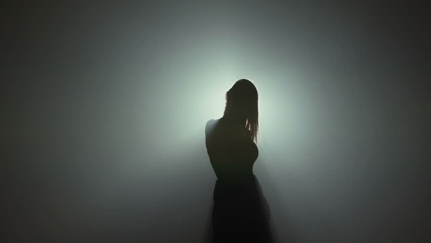 Silhouette of a beautiful happy healthy woman dancer in lights   #20670514