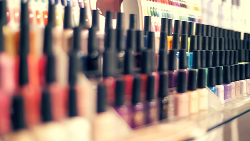 Rows of colorful bottles of nail polish on the showcase of store. Closeup. Dolly shot. Shallow depth of field Royalty-Free Stock Footage #20672146