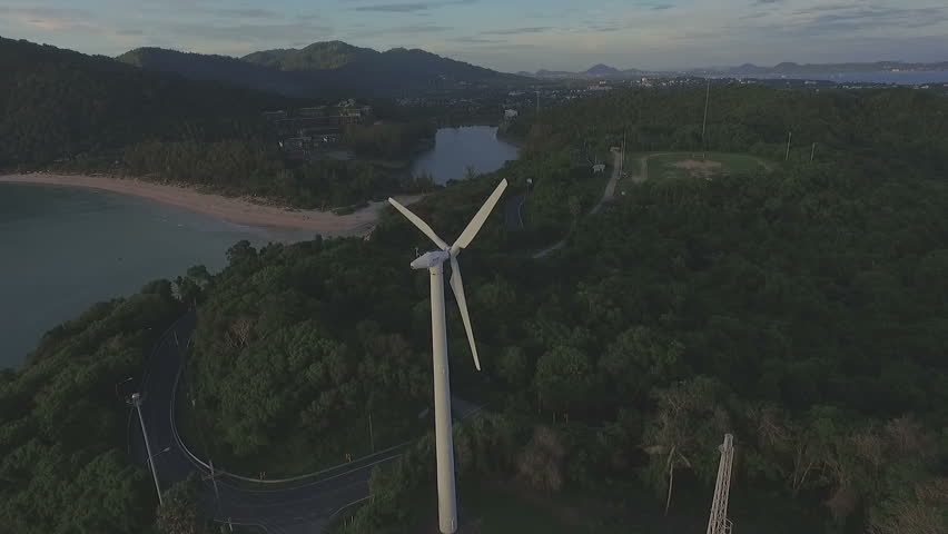 wind turbine on hilltop beside the sea near Phomthep cape viewpoint  foothill of wind turbine is Nui beach small beach it in the middle of Phomthep cape and wind turbine   #20683528