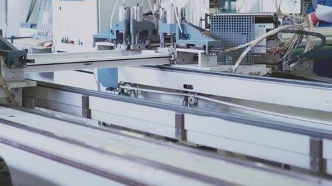 Welding of PVC profiles. Welding of PVC window profile. Welding machine for windows. Automatic production. T Production of plastic windows. Components of PVC windows. PVC window production technology.