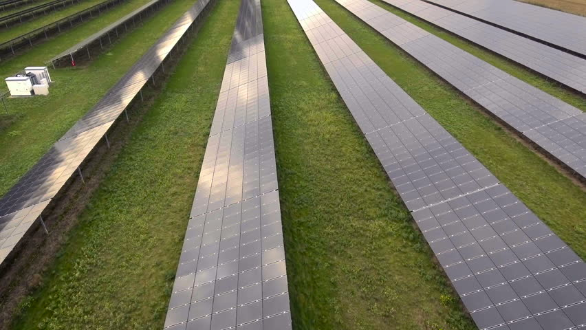 Green energy concept - solar panels straight forward shot. Aerial view | Shutterstock HD Video #20724733