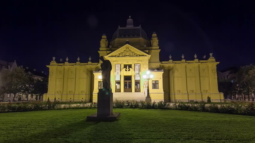 Art pavillion in Zagreb night timelapse hyperlapse. Croatia. Monument in front of facade on lawn | Shutterstock HD Video #20739013