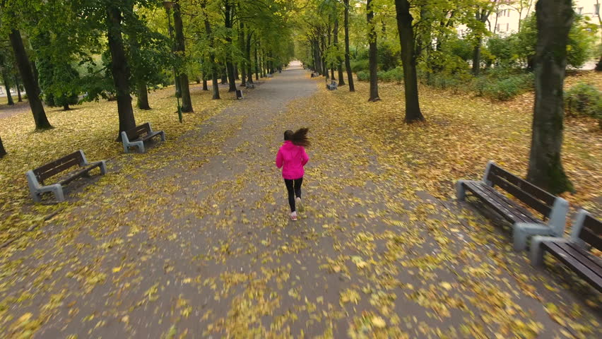 A young woman running / jogging in the city park. Aerial View  | Shutterstock HD Video #20739265