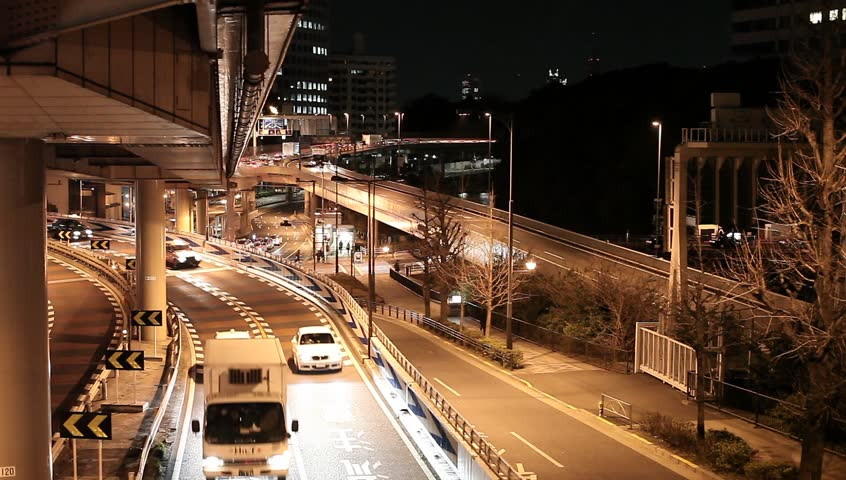 Metropolitan highway with cars at night in Tokyo, Japan