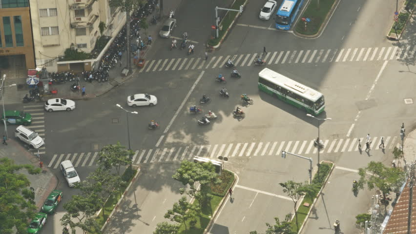 Crossroads and traffic. Movement of cars and motorcycles. Saigon. VietNam.
