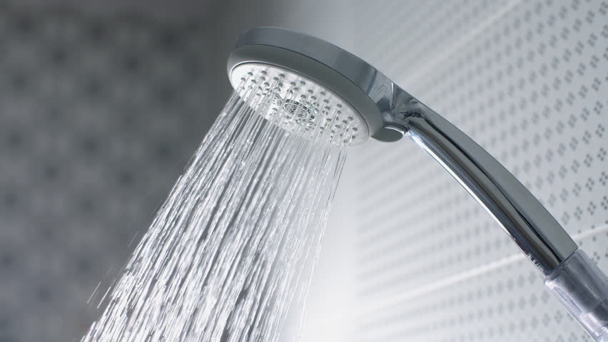 Water flow in the shower head. Slow motion stock footage