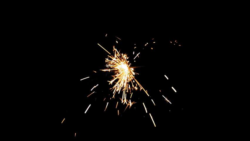 Sparkler Over Black (HD). Gun powder sparks shot against deep dark background. Ambient audio included. Slow Motion.