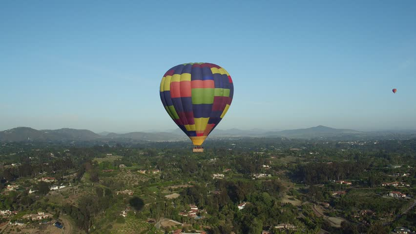Hot Air Balloon floats across the sky and over residential area in San Diego, Del Mar and Encinitas, Rancho Santa Fe, California    Shutterstock HD Video #20809354