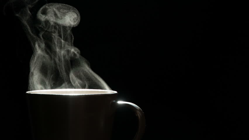 Freshly Brewed Coffee in a Mug. A trickle of steam rises and twists gracefully from a cup of hot Coffee. Backlight illuminates brown cup on a black background. Shooting at a rate of 240fps