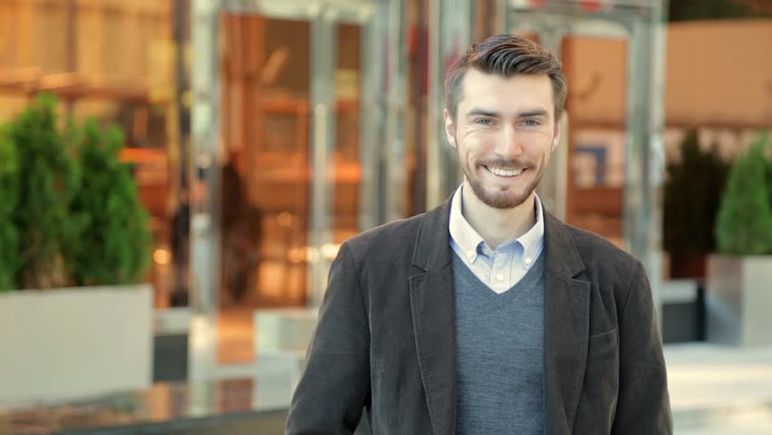 Portrait of handsome happy smiling man with a beard laughing | Shutterstock HD Video #20821441
