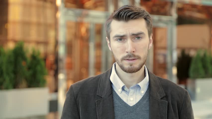 Attractive man is upset and stressed about events in his life | Shutterstock HD Video #20821471