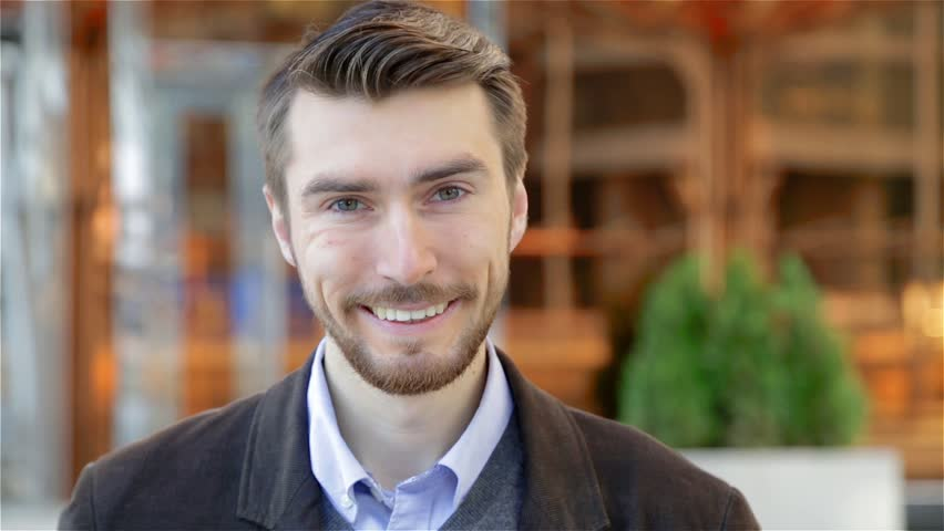 Portrait of handsome happy smiling man with a beard laughing | Shutterstock HD Video #20821798