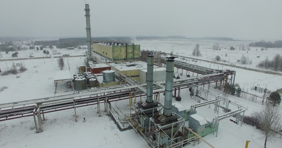 Thermal power plant aerial - gas oven various flights around the gas oven in winter frosty cloudy day