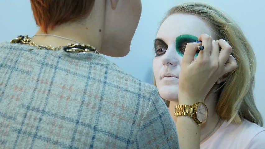 Professional make-up artist, using makeup to create a mask on Halloween. colors eye   Shutterstock HD Video #20829355