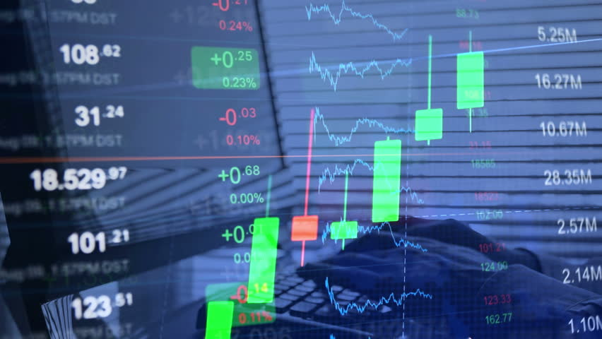 Financial background, online trading concept: stock market trading board, tickers, stock quotes, growth chart. On the background a businessman trader working on the computer, typing on the keyboard. | Shutterstock HD Video #20843008