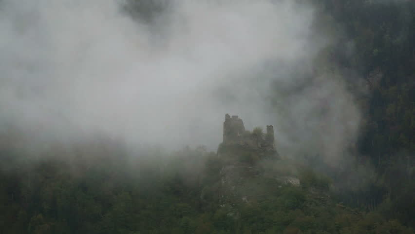 Morning fog over the ruins of the tower in the Caucasus mountains, Georgia. | Shutterstock HD Video #20847709