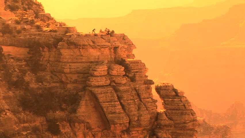Grand Canyon National Park, South Rim,  nondescript tourists walking along rim   Shutterstock HD Video #208780