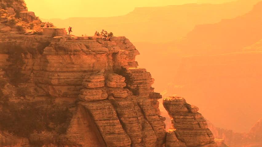 Grand Canyon National Park, South Rim,  nondescript tourists walking along rim   Shutterstock HD Video #208786
