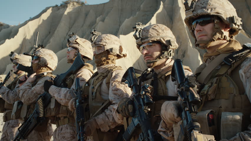 Group of Fully Equipped Soldiers Standing in a Line in the Desert. Shot on RED EPIC Cinema Camera in 4K (UHD). | Shutterstock HD Video #20883199