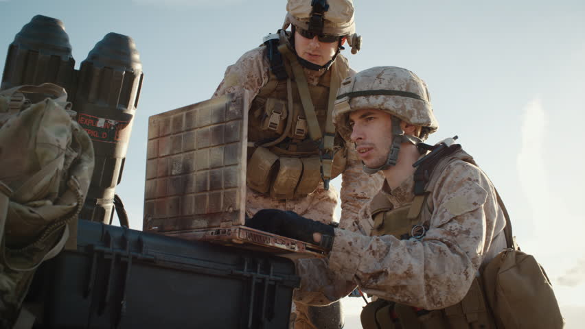 Soldiers are Using Laptop Computer for Surveillance During Military Operation in the Desert. Slow Motion. Shot on RED EPIC Cinema Camera in 4K (UHD).