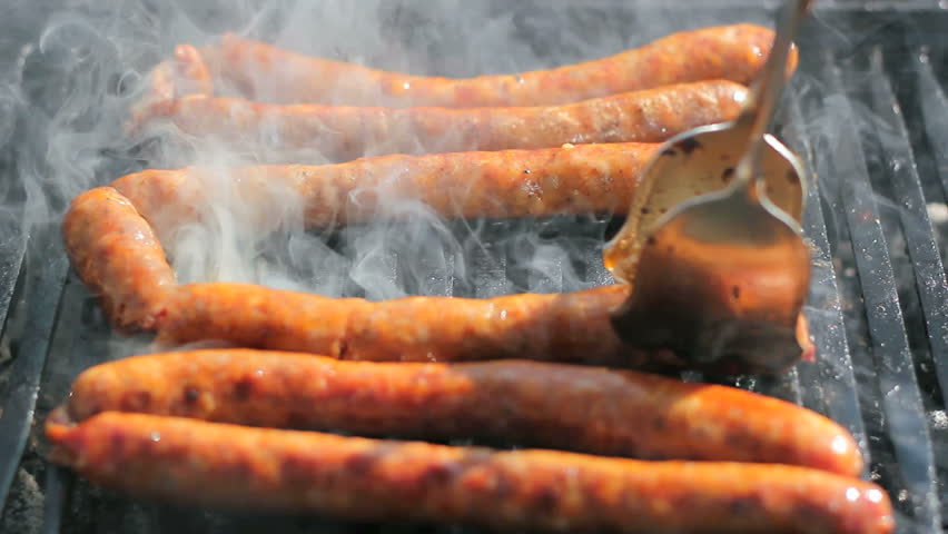 Sausages on the barbecue grill. Shallow depth-of-field. Selective focus. HD1080i.