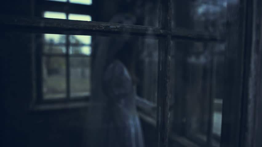 Dead girl near the old window in the haunted house | Shutterstock HD Video #20901946