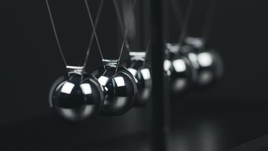 Slow motion shot of a Newton's Cradle. | Shutterstock HD Video #20922820