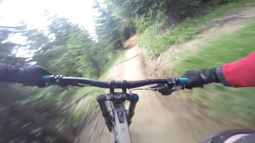 Mtb Mountain biker crash with downhill bike. Cyclist rides a single trail with berms, hits a tree with his handlebars and crashes.  | Shutterstock HD Video #20954296