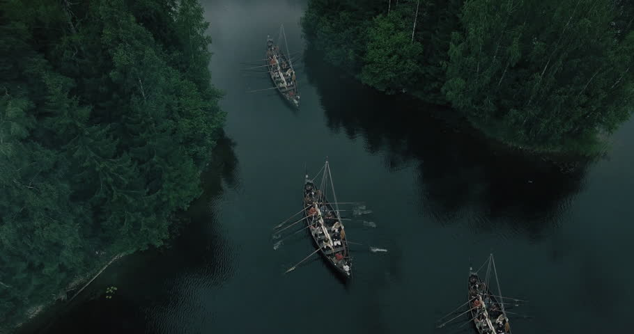 Flying over Sailing Viking Row Ships. Medieval Reenactment. Shot in 4K (UHD).