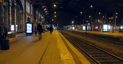 STRASBOURG, FRANCE - CIRCA 2016: People waiting for the TGV fast train at the railroad platform at the beautiful train station of Strasbourg, Alsace, France
