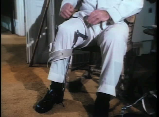 Man removing leg brace | Shutterstock HD Video #2098049