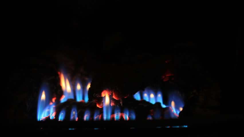 Blue flame of a gas heat stove - close up