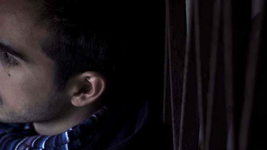 Serious creepy young man in twilight looks at the camera | Shutterstock HD Video #20984536
