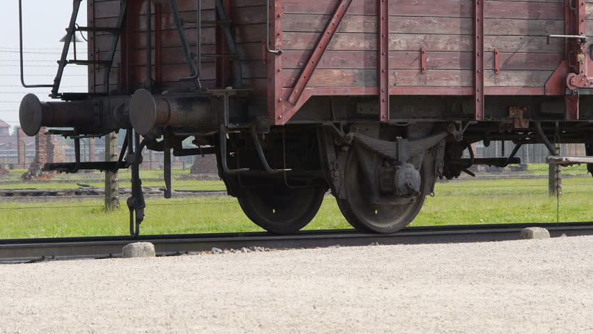 Auschwitz: Train car close up, wide shot with a camera pan bottom to top. Tight shot with no space to the left.
