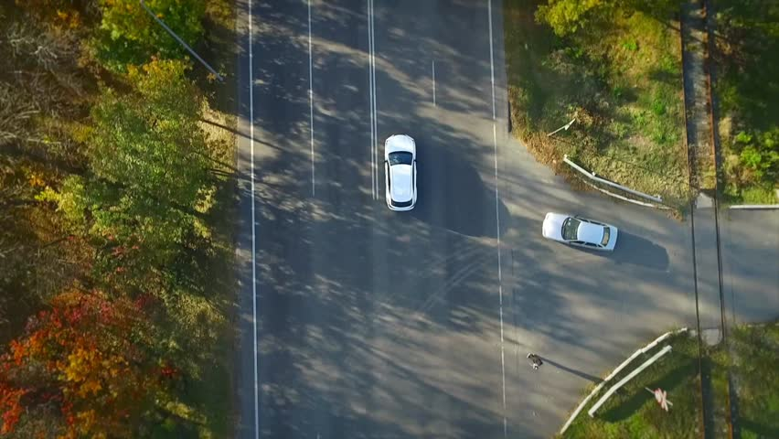 White car rides on the road, the entry of air, autumn    Shutterstock HD Video #20997868