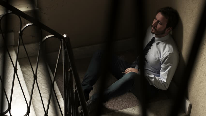 Detail of elegant man on the stairs smoking a cigarette | Shutterstock HD Video #21003316