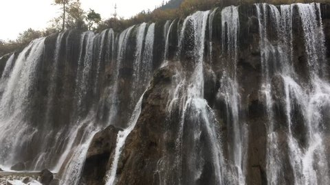 Grand  Great waterfalls at Jiuzhaigou National Park  where is the UNESCO World Heritage in Sichuan , China in  Autumn in November located in  in  Tibetan-Qiang of Sichuan ,China