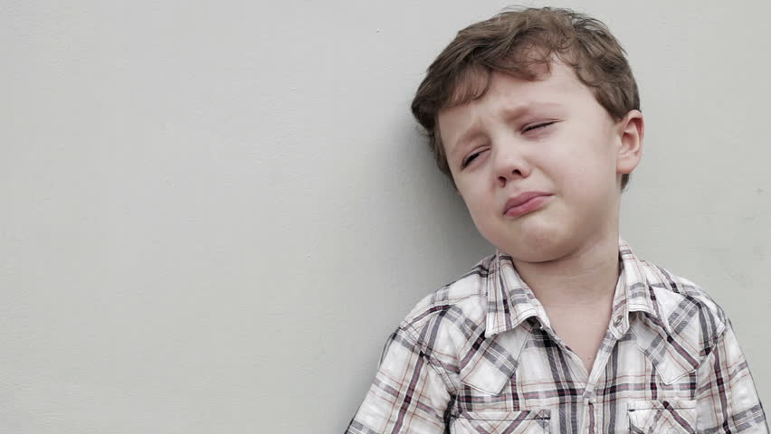 Portrait of crying little boy outdoors at the day time