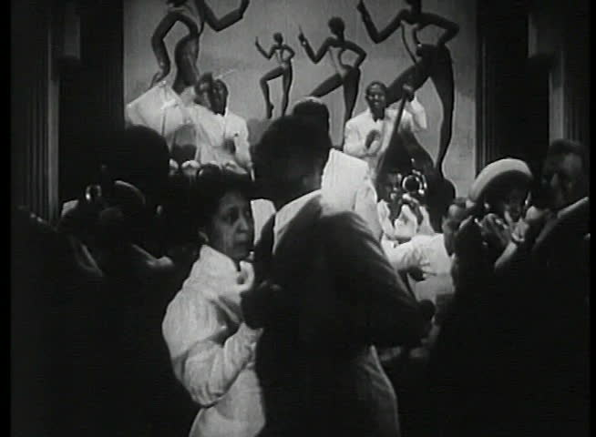 Band leader conducting musicians in1930s nightclub