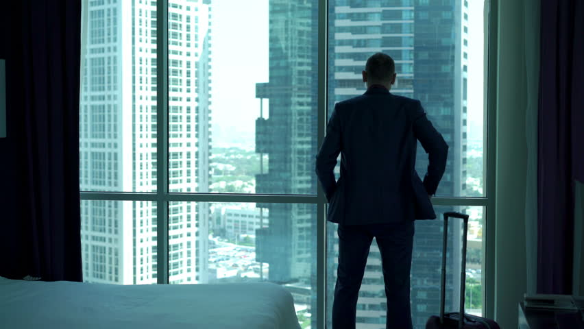 Young businessman enter the hotel room with splendid view and looking through the window, 4K  #21064216
